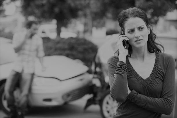 Woman calling the police after a car accident