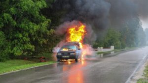 Car after accident engulfed in flames