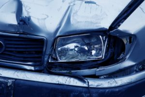 Damaged headlight and front of car